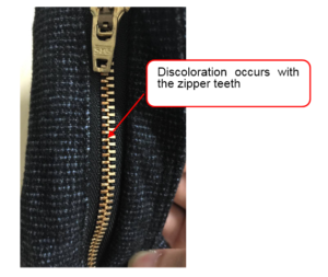 Discoloration occurs with the zipper teeth